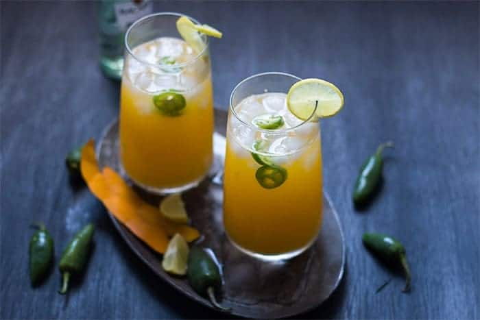 Tall Mango Jalapeno Fizzy Cocktail is a super fun and refreshing brunch drink which combines the sweetness of mangoes with a spicy kick from Jalapenos.
