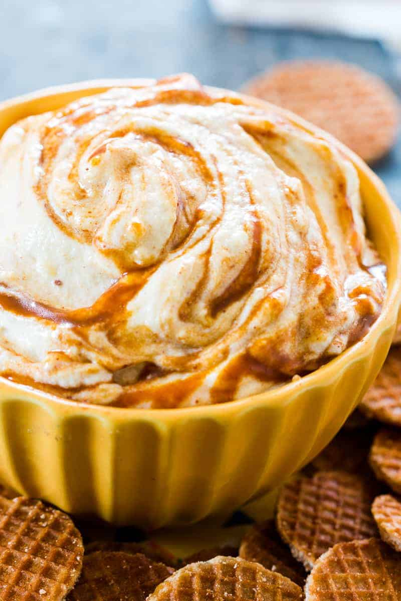 This caramel pumpkin pie cheesecake dip is a breeze to make and the perfect fall holiday appetizer or dessert. We use whipped cream instead of Cool Whip for more volume and flavour. That's one less processed ingredient for you to worry about, which makes this slightly healthier too. Serve it with graham crackers or like we did - waffle bites!