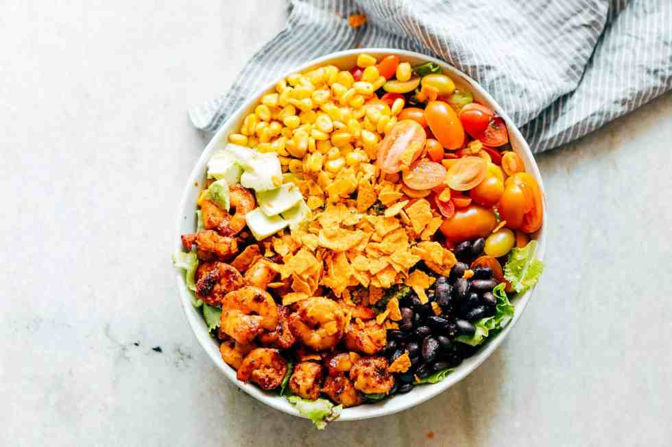 Mexican Prawn Avocado Taco Salad is a delicious, hearty salad that has all the flavours of your favourite mexican taco, but healthier. Loaded with lettuce, black beans, avocado, cherry tomatoes, corn and a delicious cilantro lime dressing, it's perfect when you want salad for dinner.
