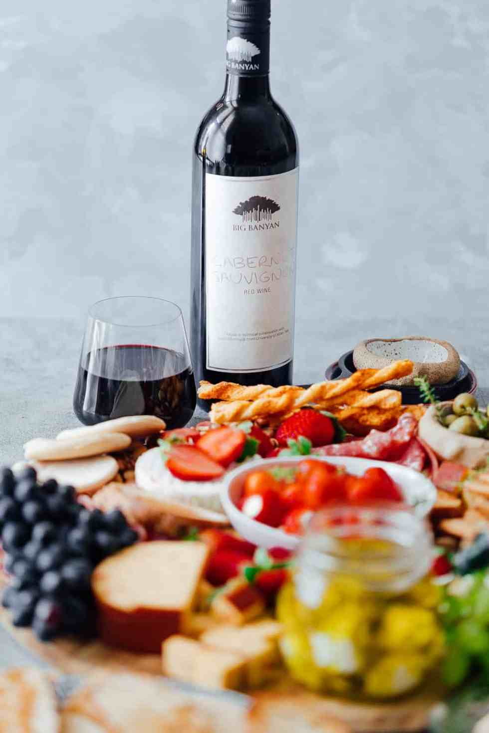 The ultimate wine and cheese board on a budget is not complete with the perfect wines. Pictured here is a cabernet sauvignon with the cheese platter