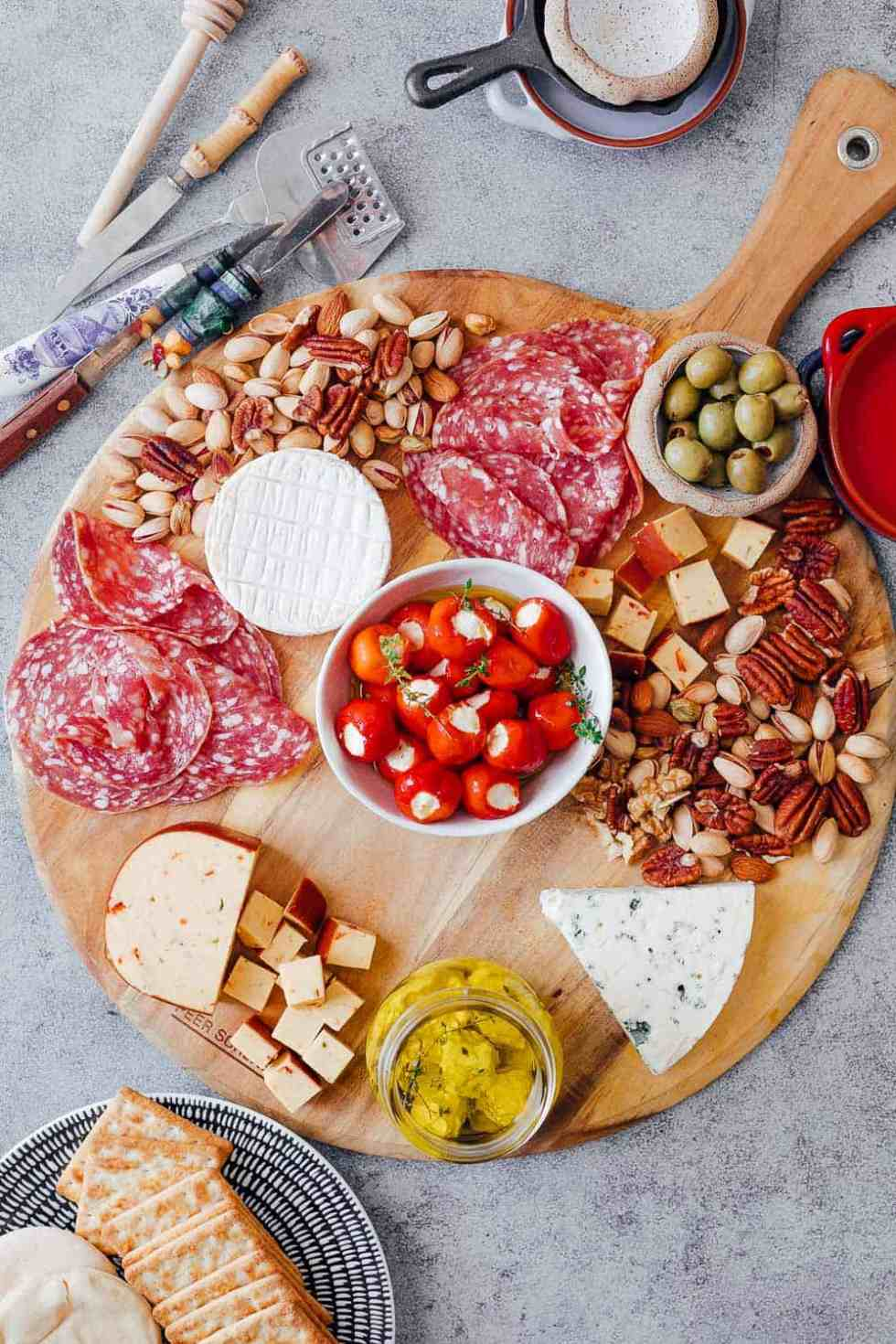 Step #4 is to add salty nibbles such as olives, stuffed peppers, labneh etc to the ultimate wine and cheese board. Pick things that are already in your pantry so that you don't spend on anything additional
