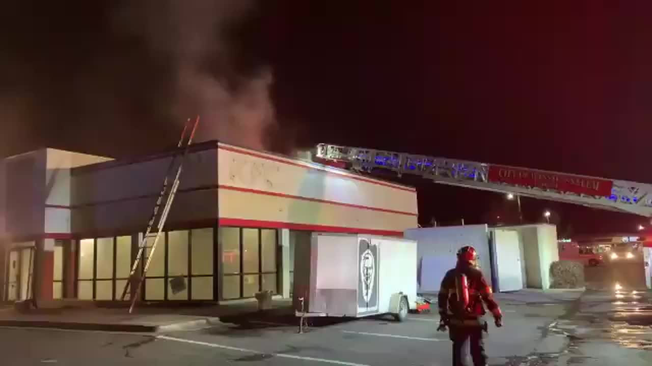 Firefighters rushed to a KFC in Winston-Salem as smoke poured from the restaurant's roof overnight.