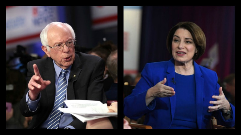 Democratic presidential candidate Sen. Bernie Sanders (left)) speaks to media in the spin room after the Democratic presidential primary debate at the Charleston Gaillard Center on February 25, 2020 in Charleston, South Carolina. (Photo by Scott Olson/Getty Images) On the right, Democratic presidential candidate Sen. Amy Klobuchar (D-MN) speaks to Chris Matthews of MSNBC inside the spin room at Bally's Las Vegas Hotel & Casino after the Democratic presidential primary debate on February 19, 2020 in Las Vegas, Nevada. (Photo by Ethan Miller/Getty Images)