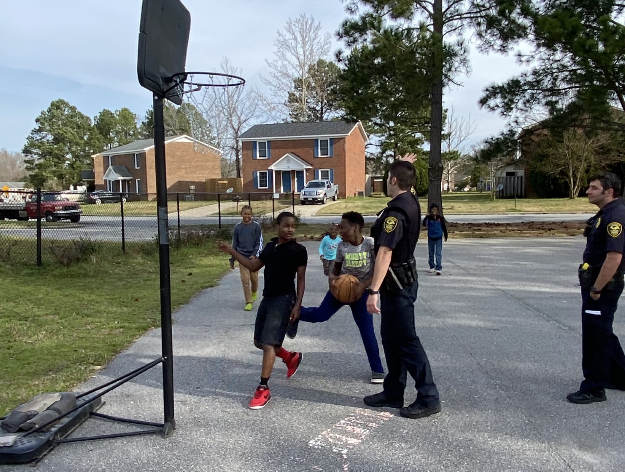 Children playing basketball with Greenville's Police Department (photo credit: Keith Combs).