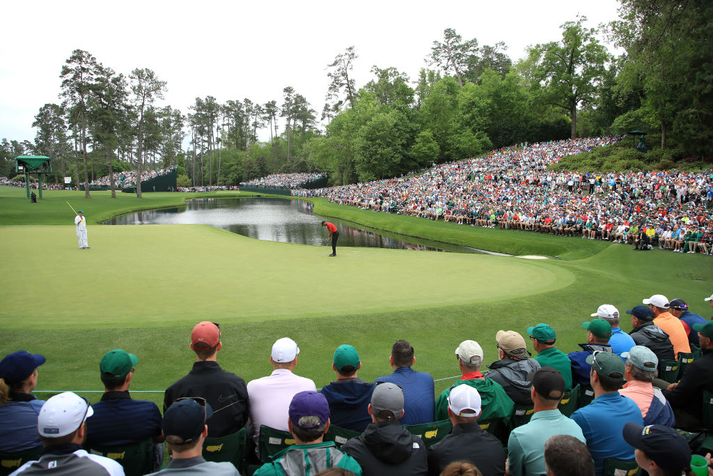 AUGUSTA, GEORGIA - APRIL 14: Tiger Woods of the United States putts for birdie on the 16th green as patrons look on during the final round of the Masters at Augusta National Golf Club on April 14, 2019 in Augusta, Georgia. (Photo by Andrew Redington/Getty Images)