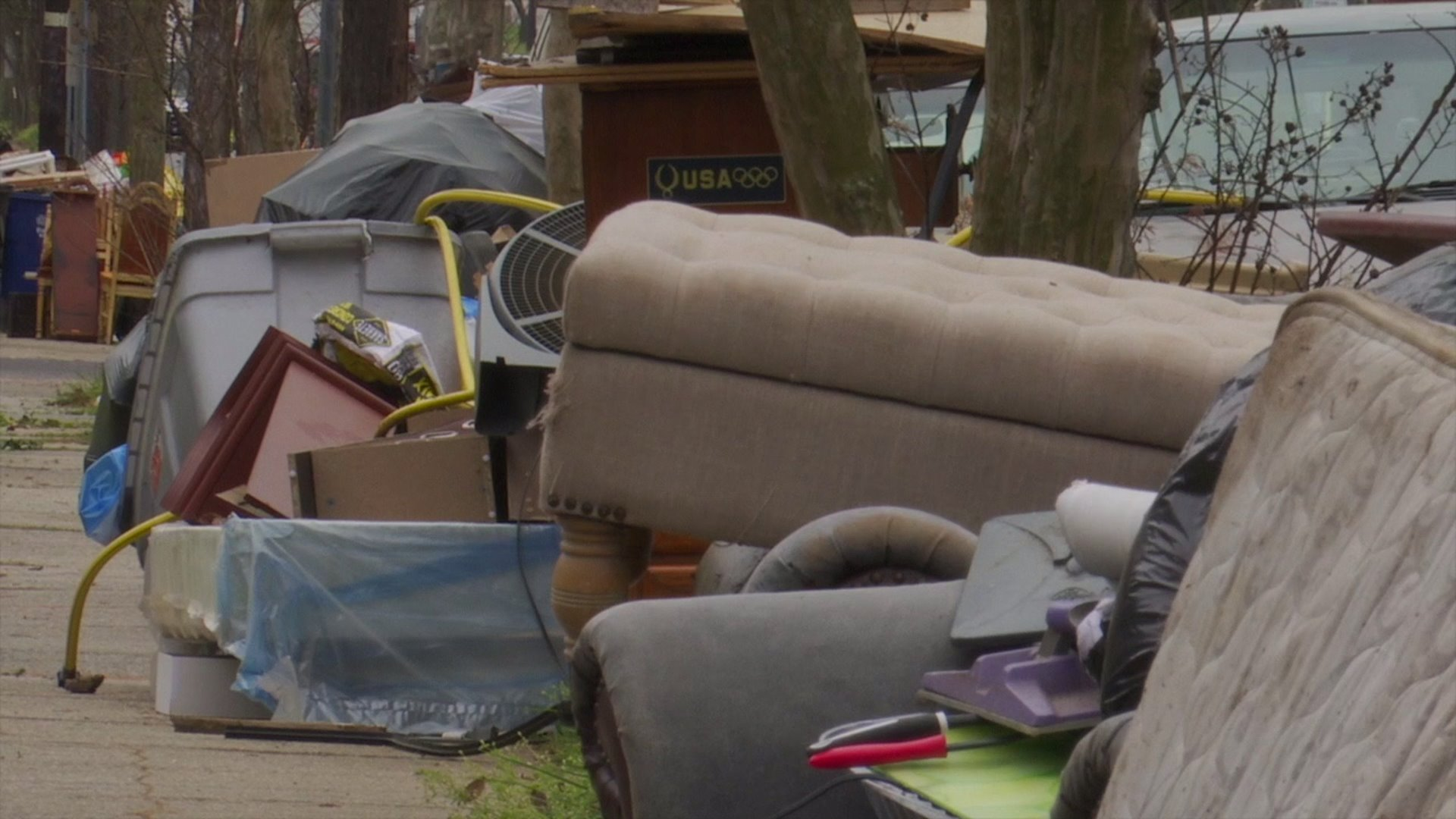 "Large items pile up along streets as Greensboro, Winston-Salem suspend ""bulky item"" pick-ups"