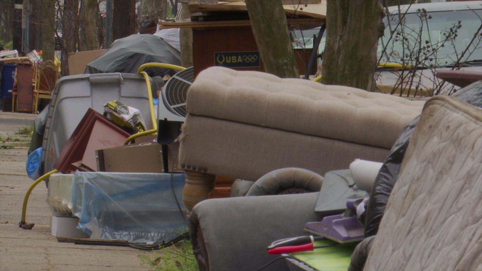"Large items pile up along streets as Greensboro, Winston-Salem suspend ""bulky item"" pick-ups"