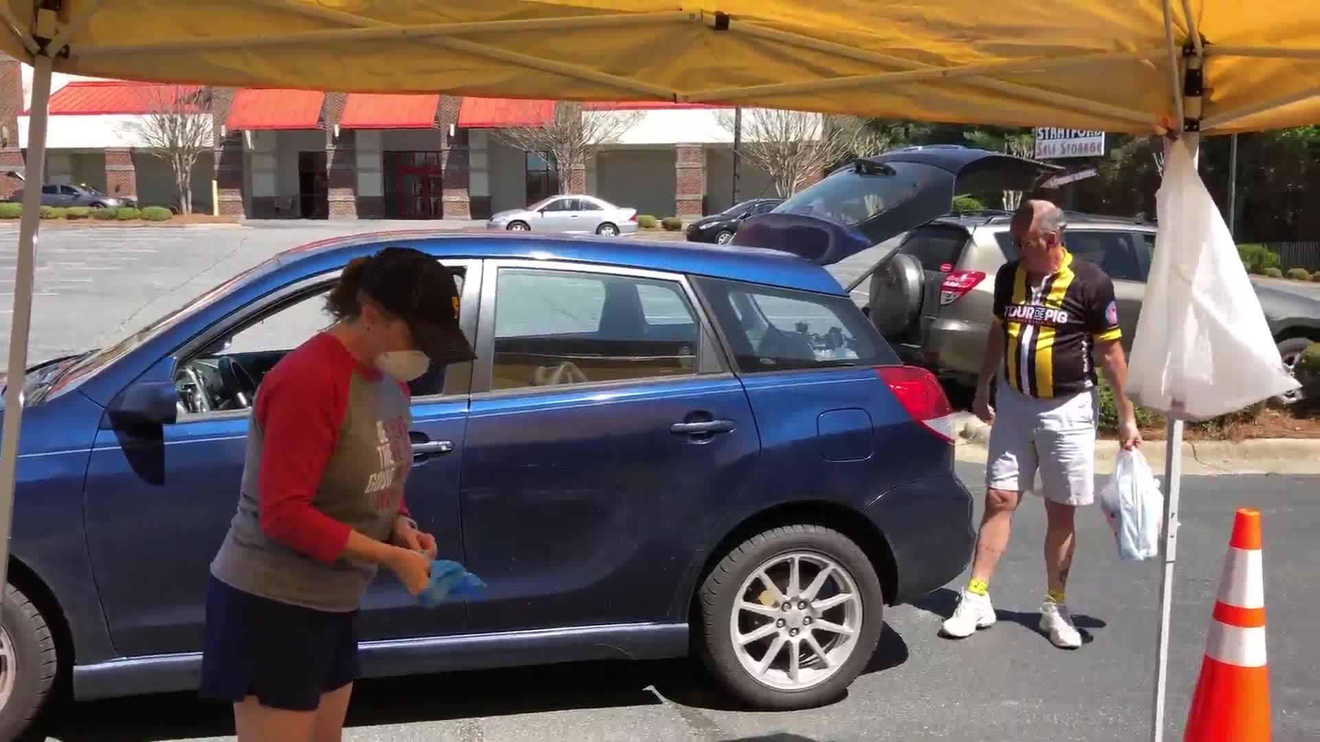 Cycling club hosts drive-thru food drive with Carabba's in Winston-Salem