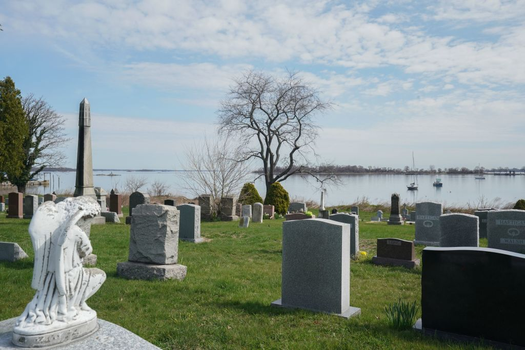 "The Pelham Cemetery on City Island and Hart Island is in Long Island Sound on April 7, 2020 in New York. - Hart Island has been the location of a Union Civil War prison camp, a psychiatric institution, a tuberculosis sanatorium, a potter's field among other uses. The mayor's spokeswoman, Freddi Goldstein, stressed that the city government was not considering using local parks as cemeteries.But she added that Hart Island, where around one million New Yorkers are buried in mass graves, may be used ""for temporary burials, if the need grows."" Mayor Bill de Blasio himself spoke of the possibility of temporary burials ""to tide us over until the end of the crisis.""We are not at that point,"" he told reporters, before refusing to give any more details. (Photo by Bryan R. Smith / AFP) (Photo by BRYAN R. SMITH/AFP via Getty Images)"