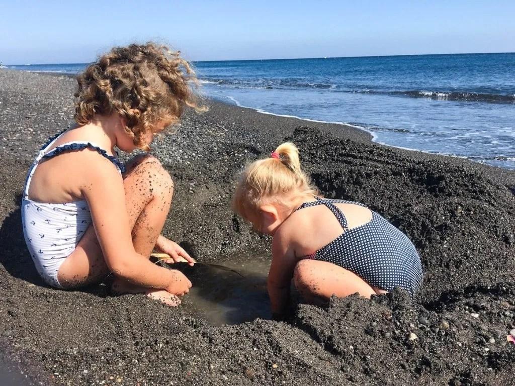 Greece with kids, black sand beaches