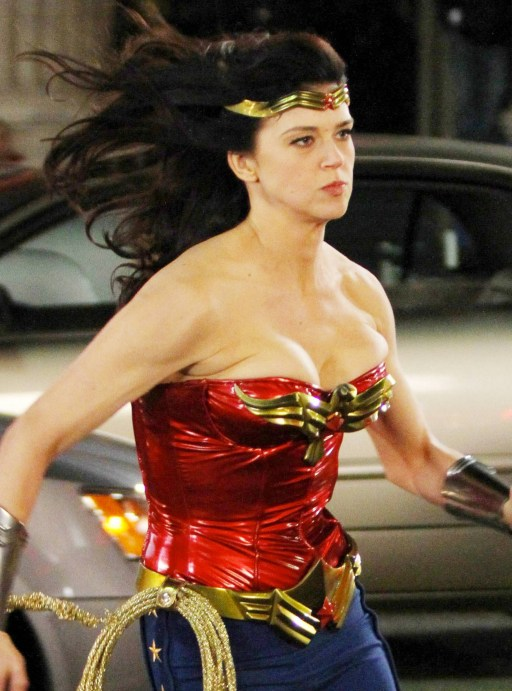 "Adrianne Palicki dashes around set and shows off her figure in her iconic Wonder Woman costume of a metallic red patent leather bustier top and blue star-detailed leggings during overnight filming of the TV series ""Wonder Woman"" in downtown LA. Adrianne donned the revamped costume including red boots, armbands, shimmery gold whip and crown for the shoot which also saw a stunt woman run over a car being chased by another actor. Adrianne, who smiled and waved to photographers, spoke with the director and later put on a black jacket to keep warm in between scenes. Los Angeles, CA. 03/29/11."