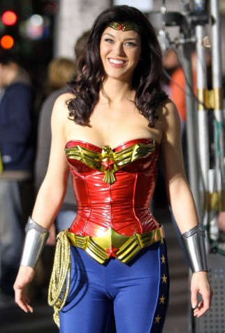 "Adrianne Palicki films scenes for her new movie ""Wonder Woman"" on set overnight. During the shoot, she films a scene with the Tin Man character from ""The Wizard of Oz"" and Darth Vader from ""Star Wars."" She can also be seen getting makeup touch-ups and chatting with a stunt double on location in Hollywood, CA. 3/30/11."