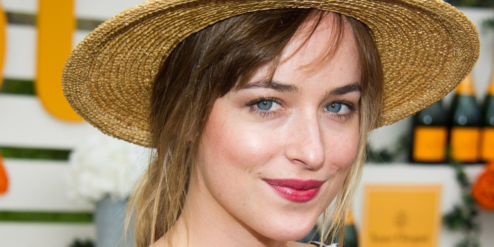 Dakota Johnson attends the Veuve Clicquot Polo Classic on Saturday, May 31, 2014 in Jersey City, N.J. (Photo by Charles Sykes/Invision/AP)