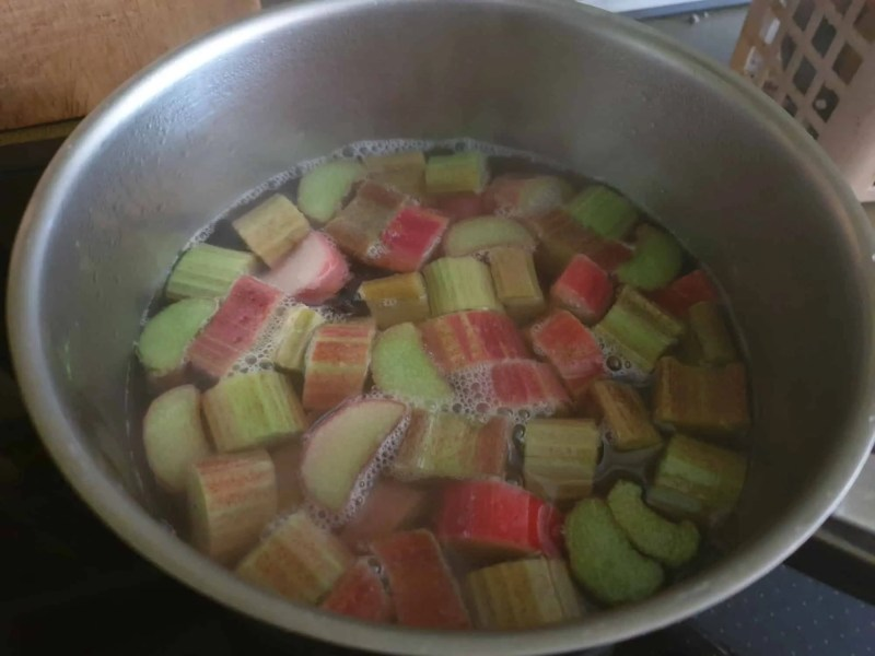 Poaching the rhubarb in syrup