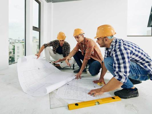 working-on-building-plan-small.jpg