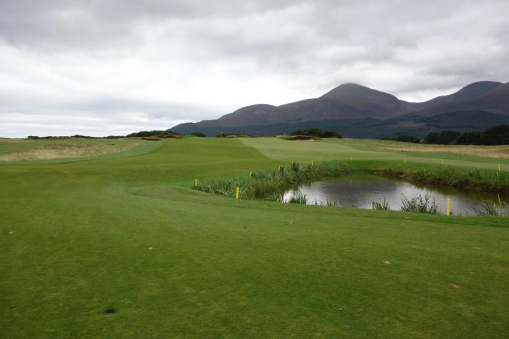 17th with water hazard in the fairway at Royal County Down