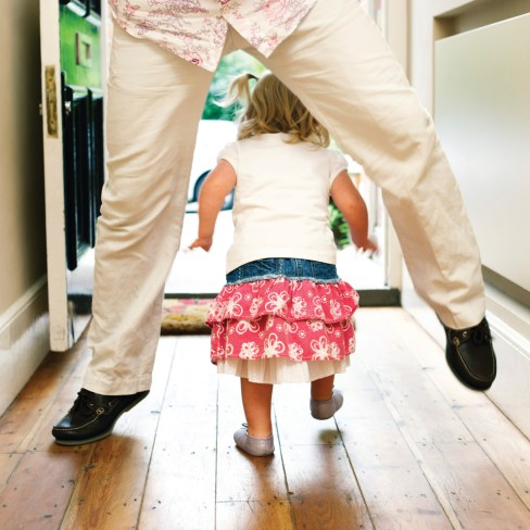 Girl Walking Through Father's Legs