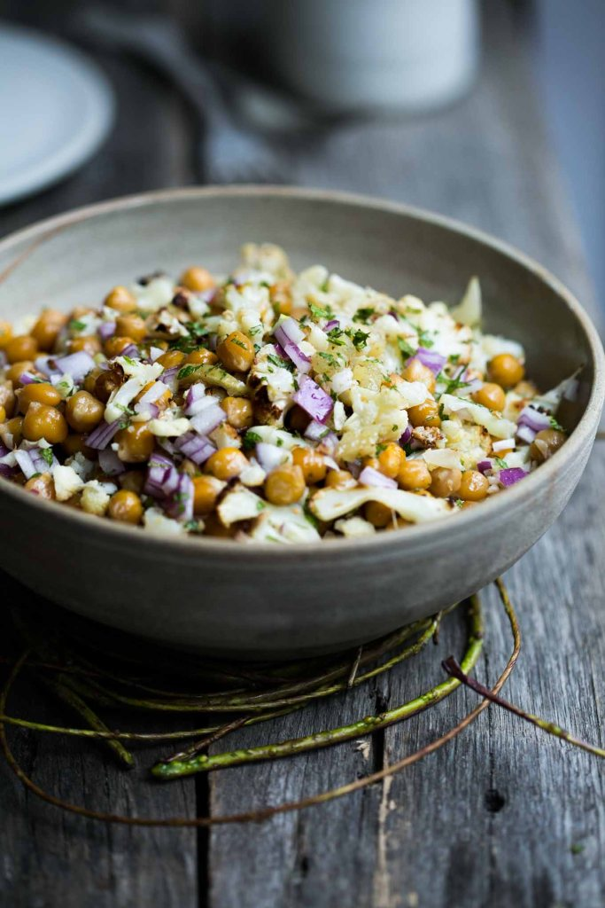 This roast chickpea and cauliflower bowl with preserved lemon and mint is a super simple vegan salad packed with exotic flavours.