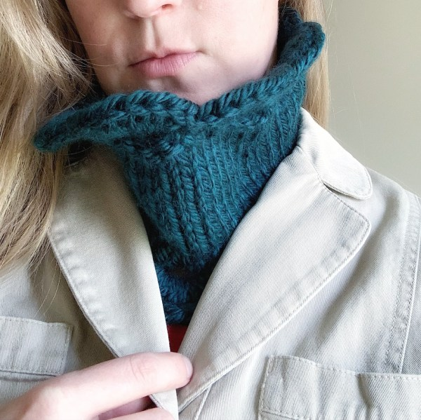 Marilue Cowl in Peacock shown tucked into a coat