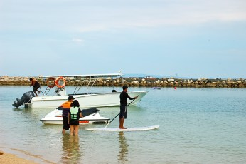 Balancing Act. Stand Up Paddle Surfing