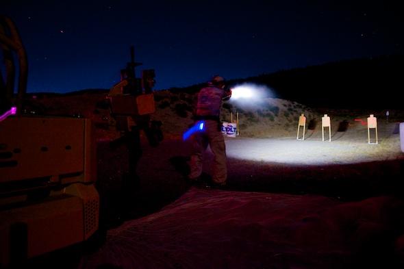 Taking aim at some handgun targets in the dark.