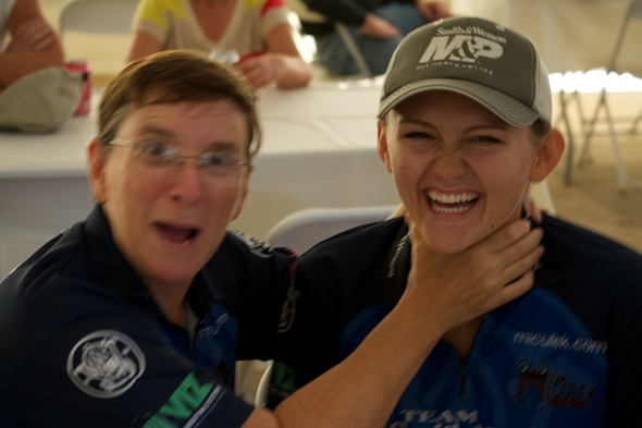 Kay Miculek tries to break daughter Lena's concentration prior to the start...