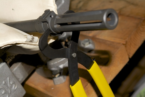 Use the castle nut pliers to loosen the nut. Looking from the breech end, the nut will turn clockwise.