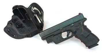 An alternate carry setup: Glock 31 with Crimson Trace Lightguard and Lasergrips. Too big? The same configuration works on a Glock compact like the 19, 32 and 23.