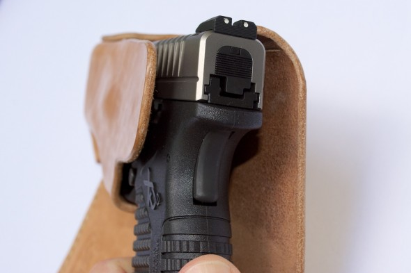 Here's the stand-out feature of Recluse Holsters - the hinge flap which hides the profile of your gun, yet still allows you to obtain a firing grip on the gun while it's holstered.