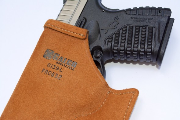 Note the rough leather exterior and hook design. Both features help keep the holster in your pocket when the gun comes out.