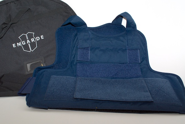The Dyneema soft panels fill the entire space of the carrier. Soft panels insert via a full-width Velcro closure across the bottom of the vest.