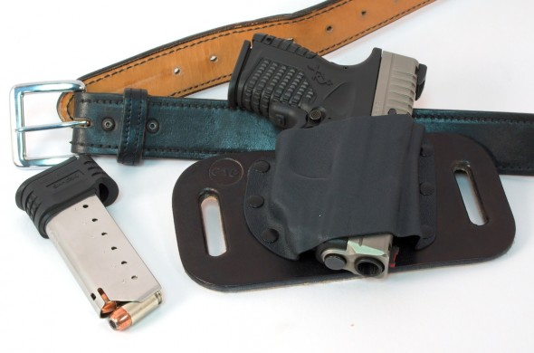 Note how high the gun rides with the CrossBreed SnapSlide holsters. Hardly anything extends below your belt.