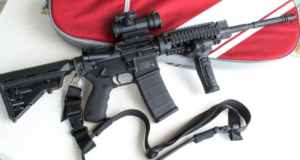 """The """"after"""" version of the Smith & Wesson M&P 15 OR. It's all geared up for the Crimson Trace Midnight 3 Gun Invitational and home defense use."""