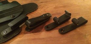 Right to left: Standard belt clips, leather snap loop, C clip and J clip.