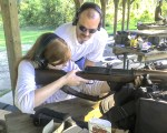 Mary Katherine takes aim with a Hakim 8mm battle rifle.