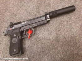 """A new Beretta 92 .22LR pistol, complete with threaded barrel and a """"faux"""" suppressor to tide you over until the tax stamp arrives for a real one."""