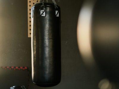 black sandbag in a dark gym