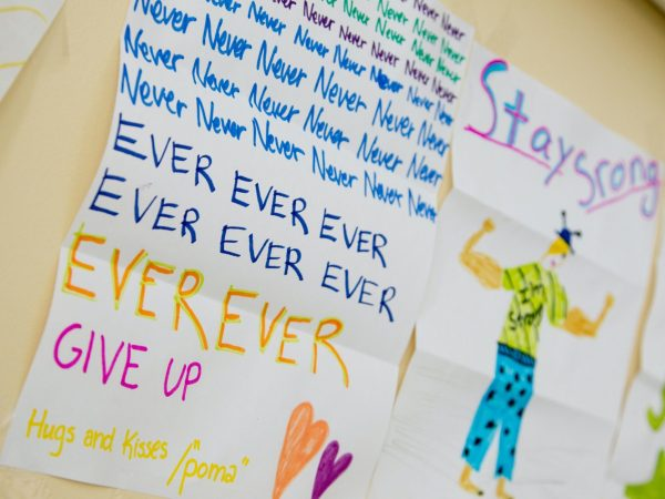 a kid drawing saying never ever give up on cancer