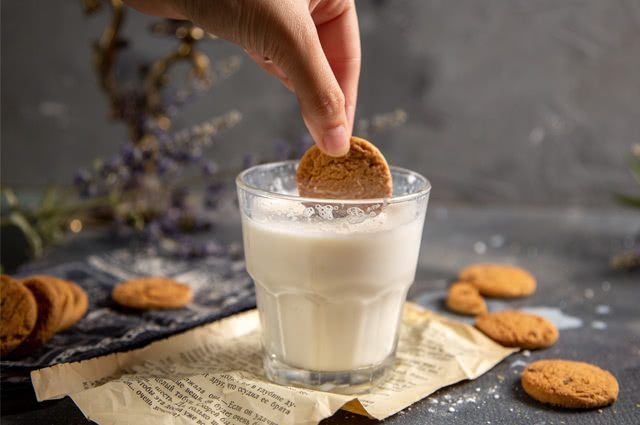Milk, biscuits and processed in a glass