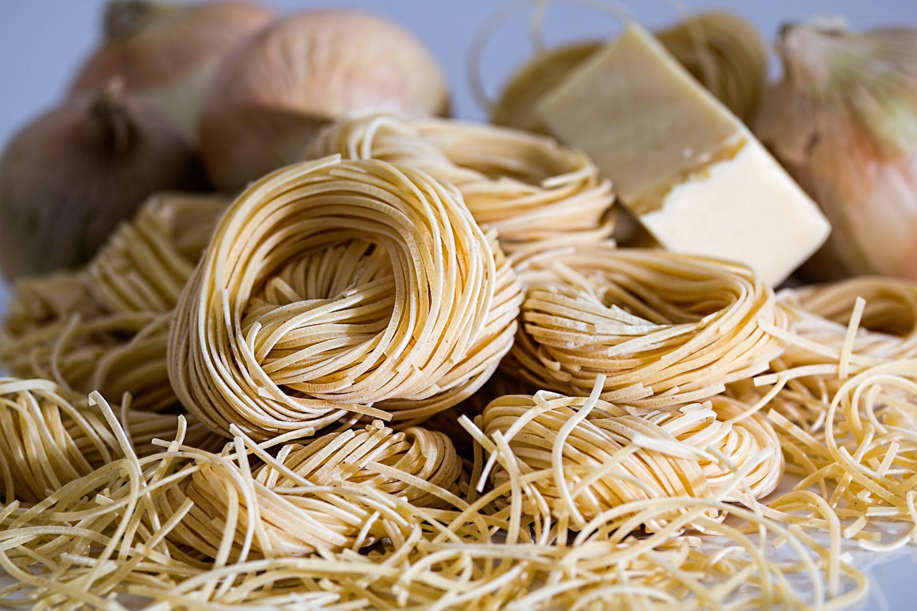 yellow pasta beside onions