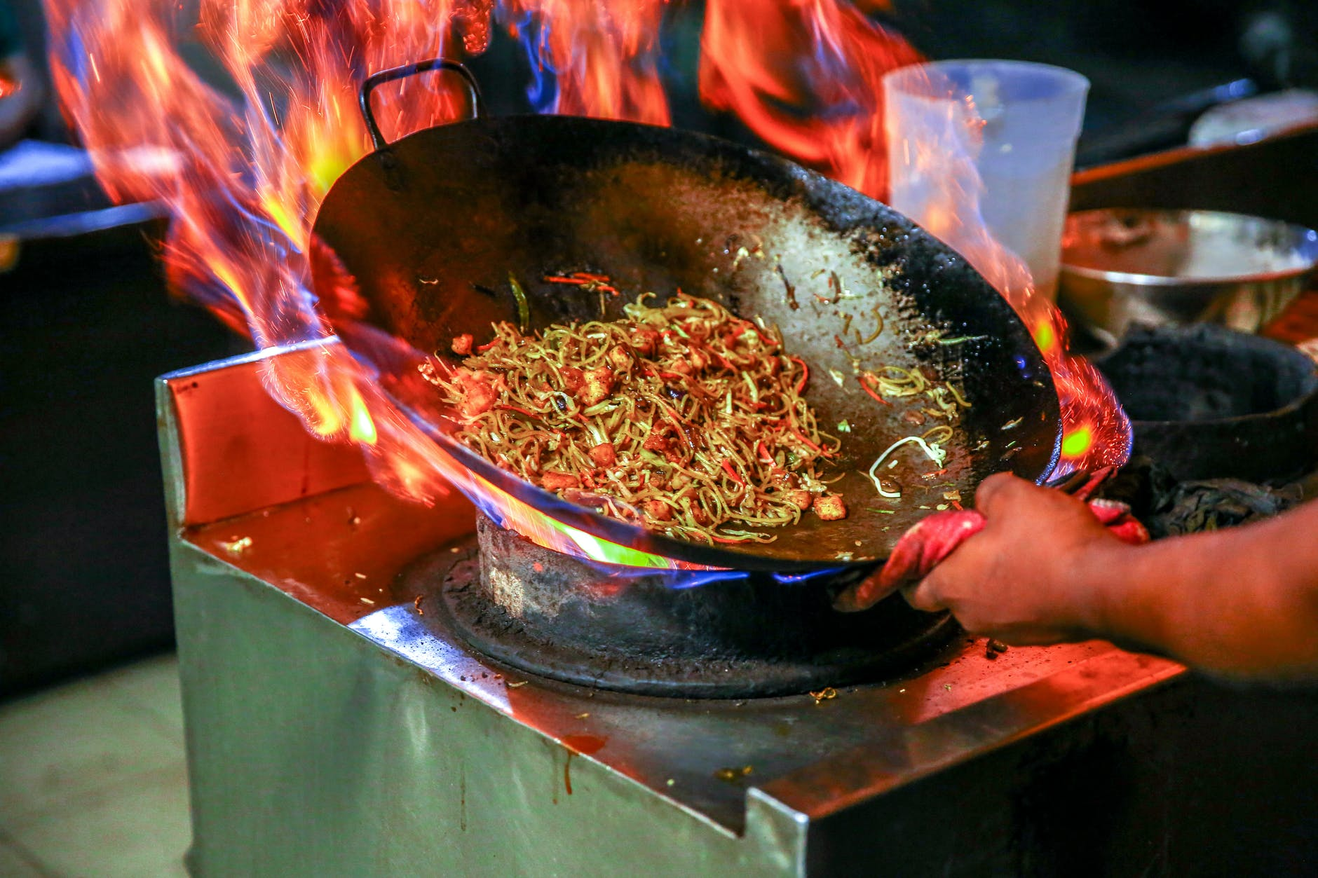 person cooking noodles