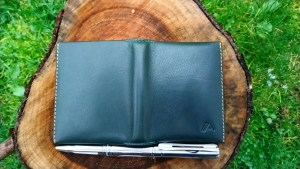 The tan stitching compliments the rainforest green leather very well