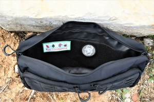 There is a Velcro strip inside the NEB10 to attach patches or hook and loop systems