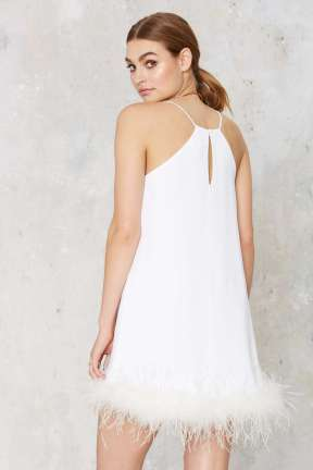 http://www.nastygal.com/product/time-after-time-feather-trim-mini-dress