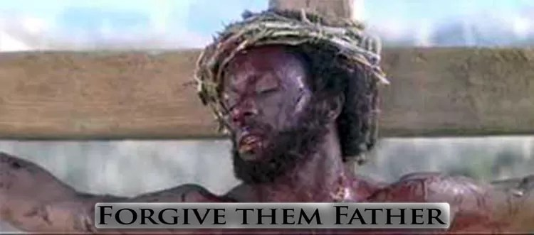 "White supremacy and black-Jesus, screenshot from 2006 Independent religious film ""Color of the Cross"" depecting black Jesus nailed to cross."