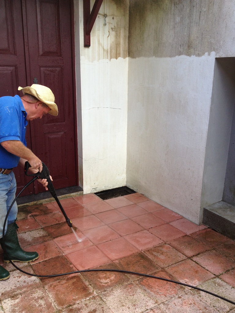 Dad pressure washing the outside tiles