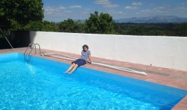 After we cleaned the pool, Laura sat on the pool edge