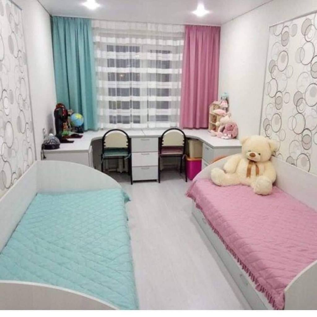 Two beds and two chairs in children's room