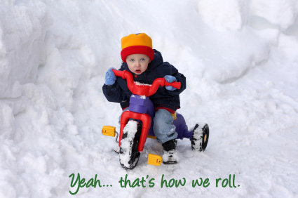 Kid on a tricycle in the snow