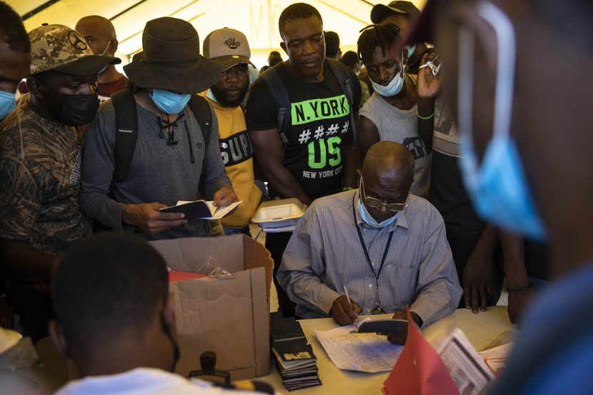 Haitians deported from the U.S. wait to receive their passports at the Toussaint Louverture International Airport,